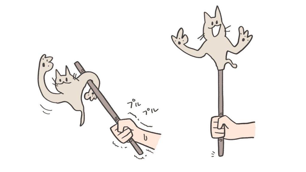 変な猫がぶらさがった棒